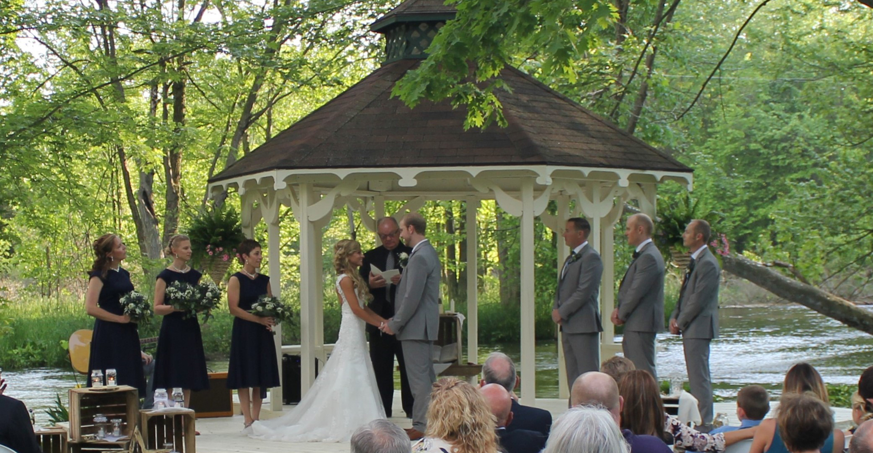 Bride and groom in the gazebo by the Prairie River