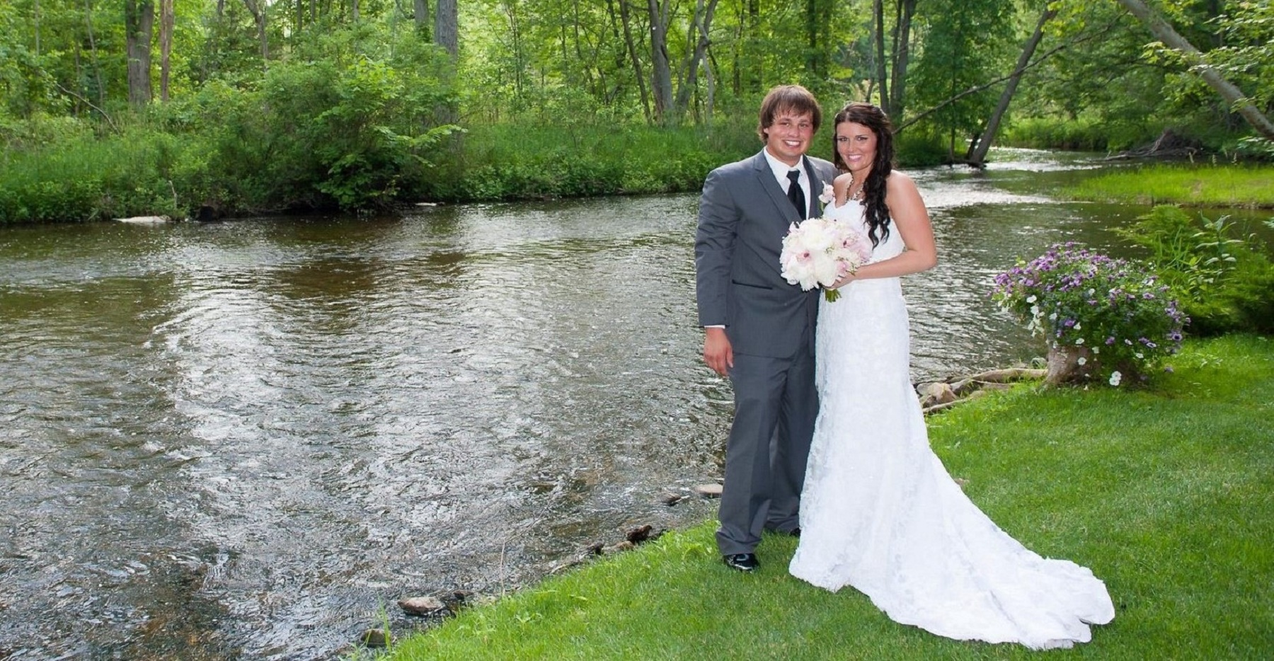 Newlywed couple by river