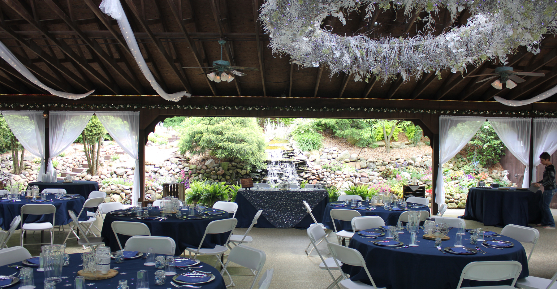 Decorated reception hall with waterfall in the background